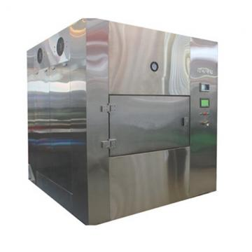 Continuous small-scale microwave vacuum dryer